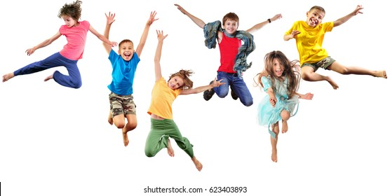 group of children shouting screaming jumping dancing. Isolated over white background. Childhood, freedom, happiness, active lifestyle concept. Young jumpers dancers kids girls and boys