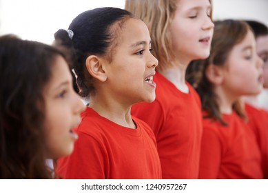 Group Of Children Singing In Choir Together