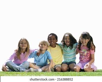 Group of children sitting on grass, smiling, portrait, cut out