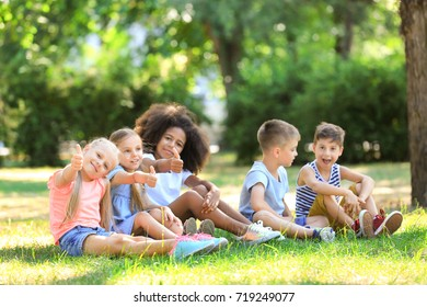 Group of children sitting on grass in park