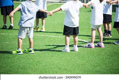 Group of children standing in playing field