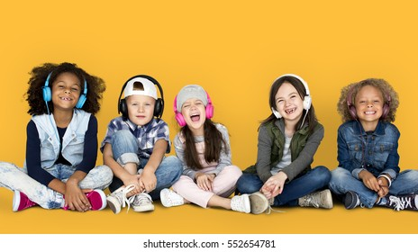 Group of Children Studio Smiling Wearing Headphones and Winter Clothes Concept