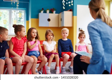 Group of children and teacher  in the preschool