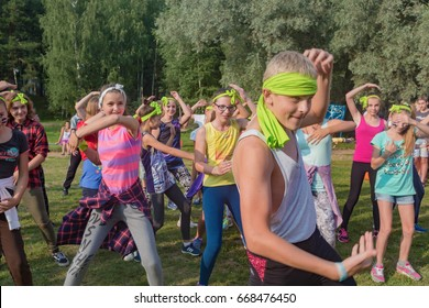 """A group of children and Teens dancing and having fun on the field. Children's camp """"Berezka"""".Editorial. Russia. Yaroslavl region 27.07.2016"""