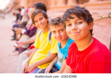 Group of children travelling together posing in row and smiling