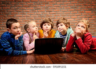 Group of children working together on computer. Educational concept.
