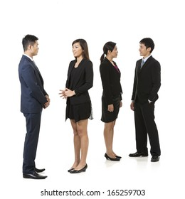 Group of Chinese business people having a conversation. Business team Isolated on white background.