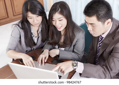 Group of Chinese business people working together in the office