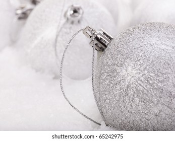 Group of christmas ball in snow.