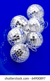 Group of Christmas disco balls on blue background.
