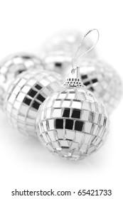 Group of Christmas disco balls on white background.