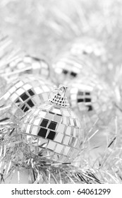 Group of Christmas disco balls in tinsel.