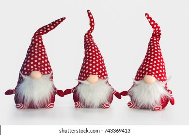 Group christmas soft toy elves isolated on white background