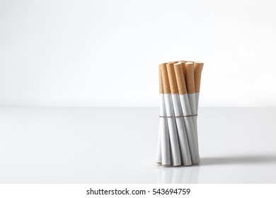 group of cigarettes wrapped up standing on white background
