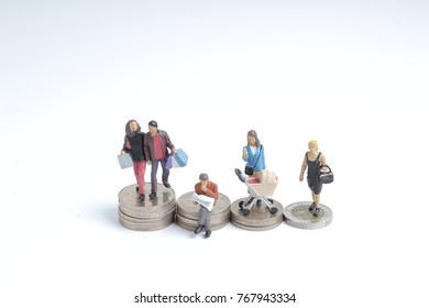 group of class of a figure stand on coins