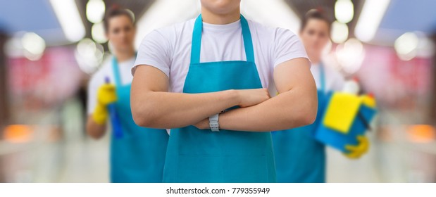 Group of cleaners standing on blurred background. Concept cleaning service.