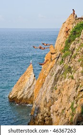 Group of cliff divers in free fly