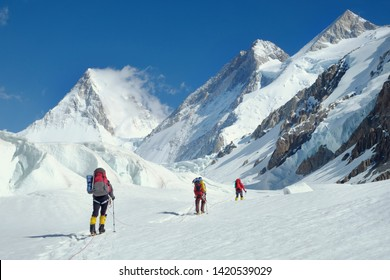 Group of climber reaches the summit of mountain peak. Nepal, Everest region.