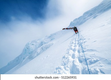 Group of climbers ascending Manaslu (8163 m) summit on fixed ropes in the Himalaya mountains