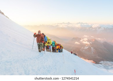 Group of climbers at dawn. Elbrus, altitude of 5200m