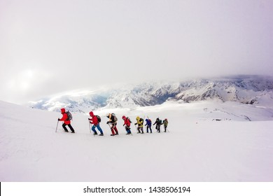 A group of climbers each other in a chain go to the conquest of the top