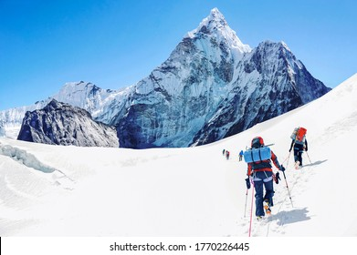 Group of climbers reaching the Everest summit in Nepal.