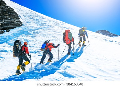 Group of climbers reaching the summit. Extreme sport