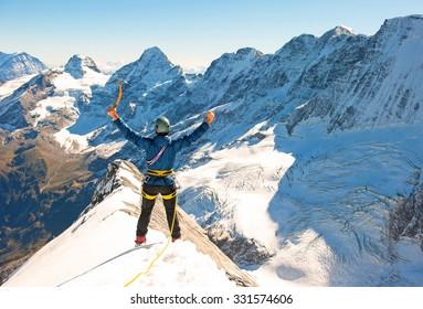 Group of  climbers reaching the summit, Nepal Himalayas