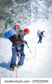 Group of climbers reaching the summit. Nepal