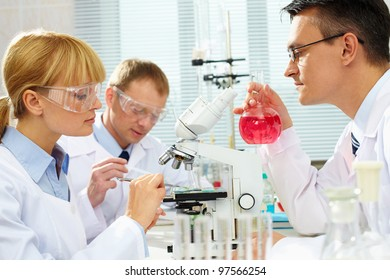 Group of clinicians studying new substance in laboratory