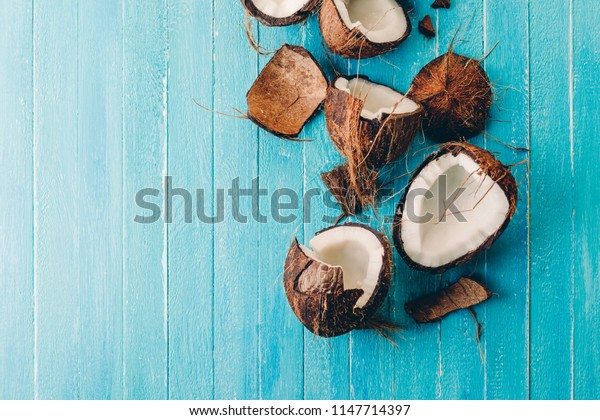 group of coconut on a blue wooden background, split, banner, copy space