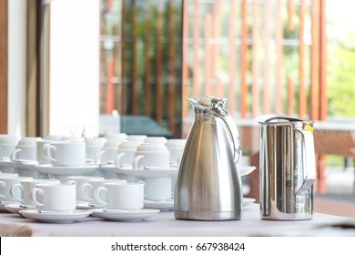 Group of coffee cup in a row with a coffee mug on table is ready to serve in break time, after meeting conference, coffee jar