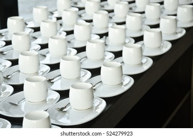 Group of coffee cups.Many rows of white cup for service tea or coffee in breakfast at buffet event.