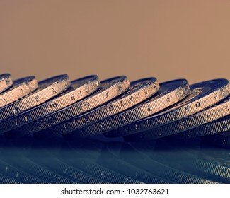 group of coins worth two euros. Euro money. Blurred background.