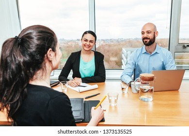 group of colleagues in office working together in a positive manner