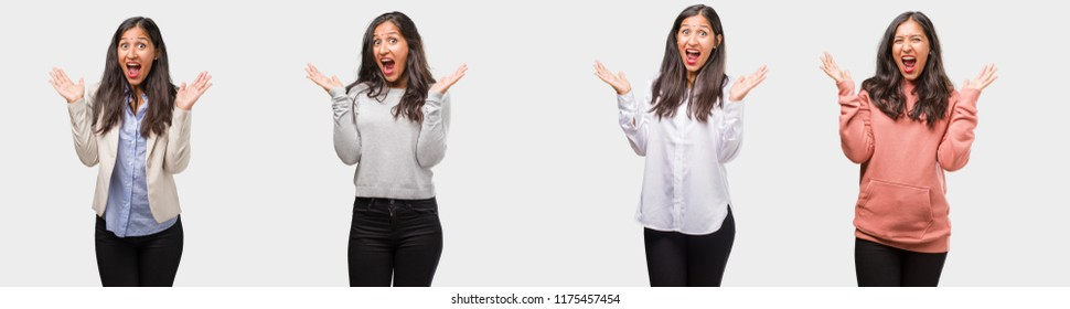 Group or collection of indian young woman wearing different clothes screaming happy, surprised by an offer or a promotion, gaping, jumping and proud