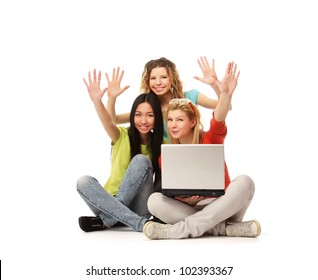 A group of college friends with a laptop