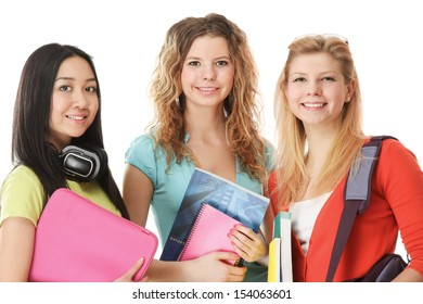Group of college girls looking their books. Full length portrait isolated on white background