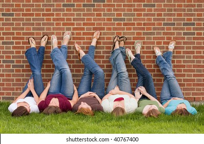 Group of College Girls at School With Legs up on Wall