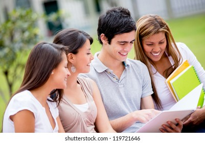 Group of college students exchanging notes outdoors