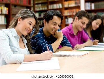 Group of college students studying at the library