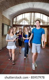 Group of college students walking through hall