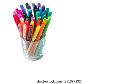 Group of color felt-tipped pens in a glass, white background, isolated