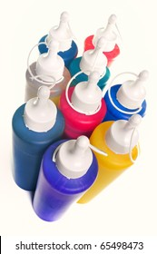 Group of color tubes over white background