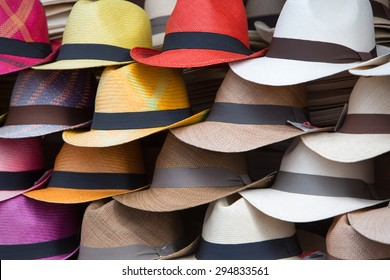 Group of colored hats for sale, hanging on a wall, Otavalo Market. Ecuador