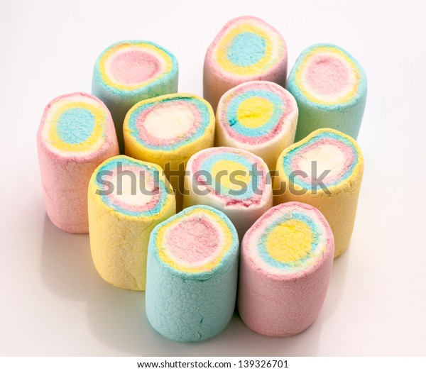 group of colored marshmallows on white background