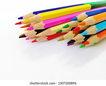 group of colored pencil isolated on white background, selective focus