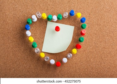 Group of Colored Pins arranged as Heart Shape