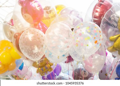 the group of colorful balloons in the graduated event