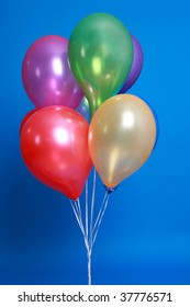 Group of colorful balloons isolated on blue background